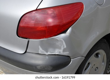 Accident damage to the rear of a car