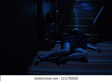 Accident. Dead beautiful woman on the stairs. Night lighting effect