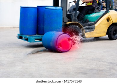 accident forklift with a pallet of barrels falling, safety first concept