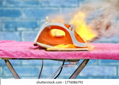 An accident with an ironing iron for clothes, device overheated and caught fire. Ignition of a household electrical appliance at home. Burning property in the apartment. Damaged equipment ignited.