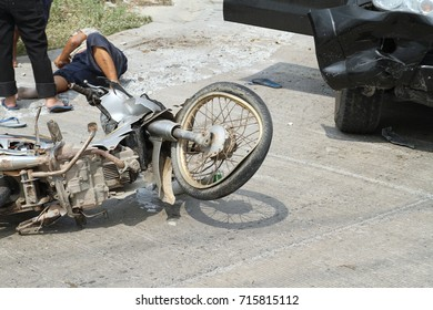 Accident motorcycle with a car on the road