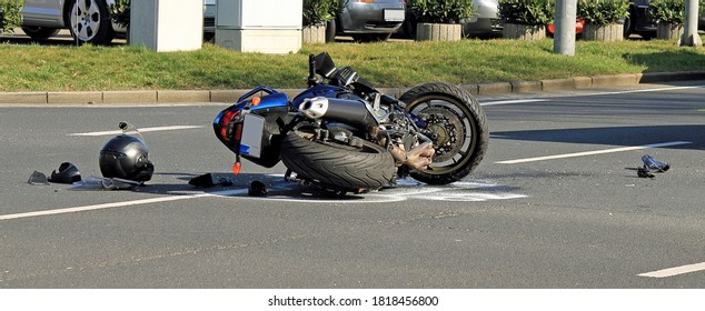 Accident with motorcycle at a crossroads