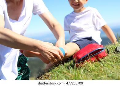 An accident on a mountain trail. The child twisted his ankle during a mountain tour. Wound broken leg.