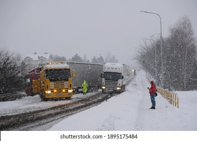 An accident on the road involving a truck in very difficult winter conditions. Roadside assistance during an accident. - Shutterstock ID 1895175484