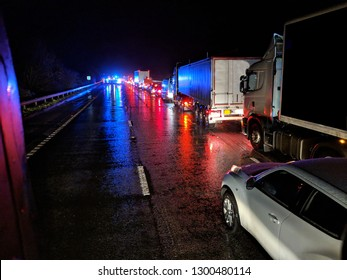 Accident on the road at night - vehicles queueing