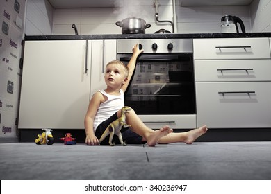accident prevention. The child unattended playing in the kitchen with a gas stove.