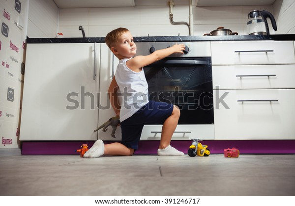 accident prevention. The child unattended playing in the kitchen with a gas stove. without retouch