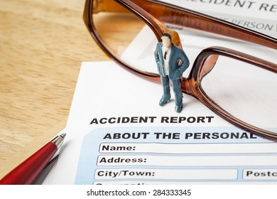 Accident report application form and businessman with pen and eyeglass, business insurance and risk concept; document is mock-up