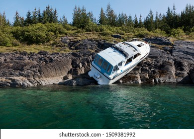 Accident at sea; photo of recreational boat on dry land after collision with rocks