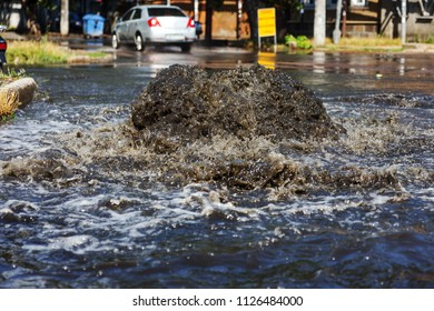 Accident sewerage system. Water flows over the road from sewer. Accident in sewer. Breakthrough sewerage system. Water flows out of manhole. Having poured water supply systems in sewer well on road