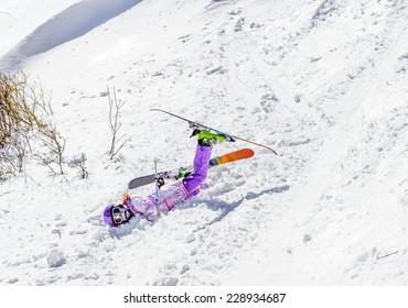 Accident at the ski resort. Little girl falls in soft snow off piste