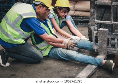 Accident at workplace, industrial engineer worker wearing helmet hit by forklift car at manufacturing plant factory construction site building, man leg stuck in forklift, colleague try to help him