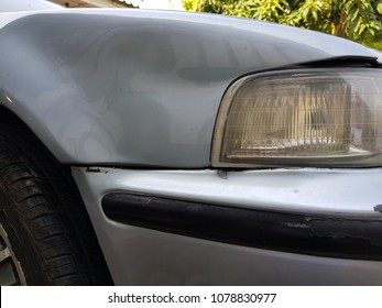 Accidents, old cars, crashed while parking, headlights almost cracked.