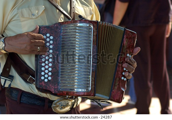 Accordian player at the Día de los Muertos - Day of the Dead Celebrations on Olevera Street, Los Angeles, California