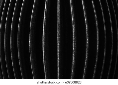 Accordion bellows. closeup of accordion bellows in white and black, vertical image, for background texture.