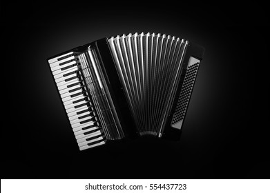 accordion on a black background