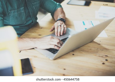 Account Manager working wood table laptop Modern Design Interior Office.Man Work Coworking Studio,Use contemporary Notebook,typing keyboard.Blurred Background.Creative process Business Startup Idea