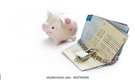 account passbooks were locked by chain and key with piggy bank on white background  account passbooks were locked by chain and key with piggy bank on white background, saving and financial concept