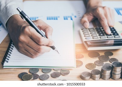 account working calculator, profit or graph economy on tables in office at home.