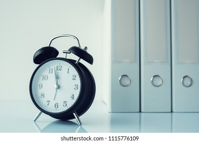 Accountancy and bookkeeping office supplies - vintage alarm clock and document files ring binders