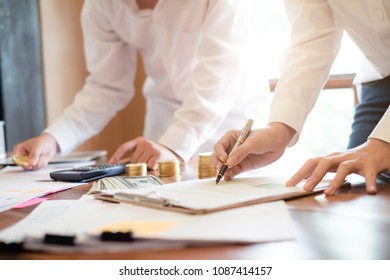 Accountant or Bookkeeper making report checking balance investment, economy verify the statement of financial statements.