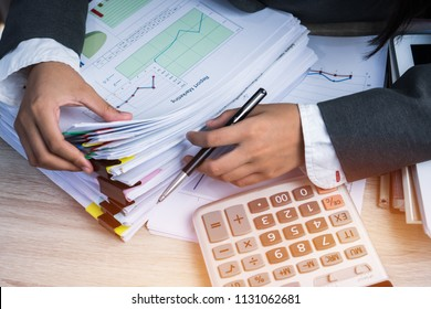 Accountant Business woman Manager checking and signing applicant filling documents reports papers company application form near calculator on desk office. Document Report and business busy Concept