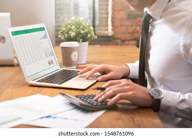 Accountant calculate tax information or business data. Businessman working in office