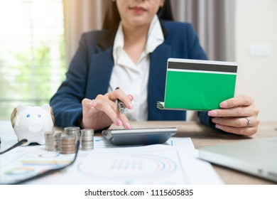 Accountant calculating the Saving Account Book and Statement of financial statements at home
