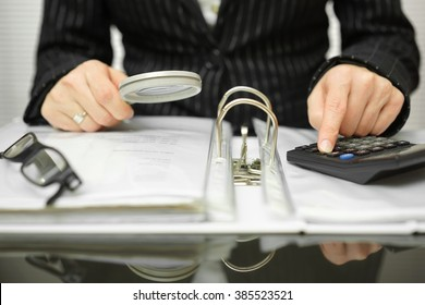 accountant is examining  invoices and documents