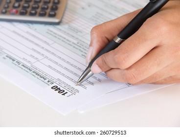 Accountant filing federal tax form 1040