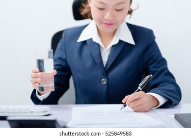 Accountant filling the form at desk.