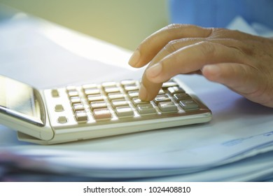 The accountant using a calculator