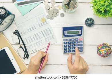 Accountant verify the Saving Account Book and Statement of financial statements / Bookkeeping / Accountancy Concept.