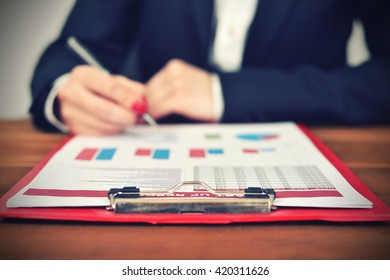 accountant woman in office with start up report on table