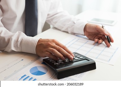 Accountant at work in his office