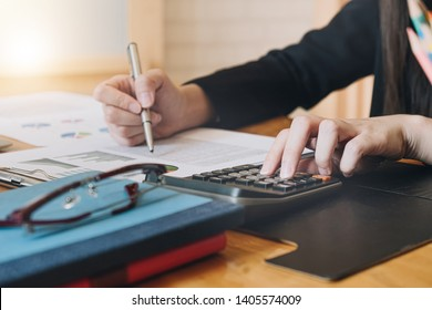 Accountant working with calculator for investigation of corruption account.