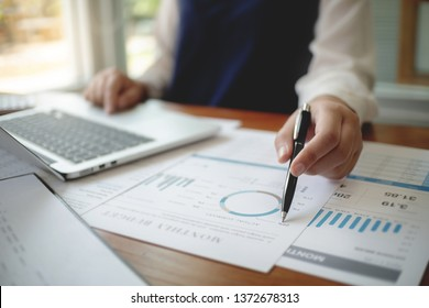 Accountant working with data documents calculating on business report.