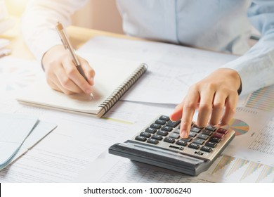 accountant working on desk in office