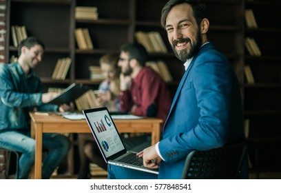 accountant works with financial charts on the laptop in the offi