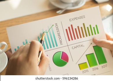 accountant works with the financial schedules in the workplace in the office