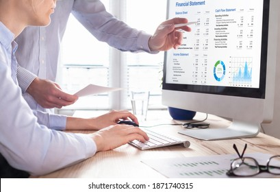 Accountants working on financial statement on computer screen in office. Team of consulant auditing finance and business operations reports with income data. Corporate management and governance