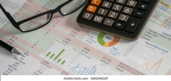 Accounting analysis businessman hand working Strategy Research analyzing financial data and charts