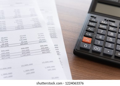 accounting business concept. calculator on financial statement and accounting report annual on accountant's desk.