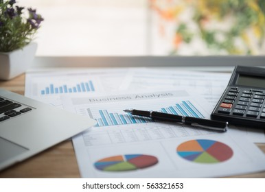 Accounting Business Concept. the report summarizes the results of business operations, pen, calculator on desk of investor.