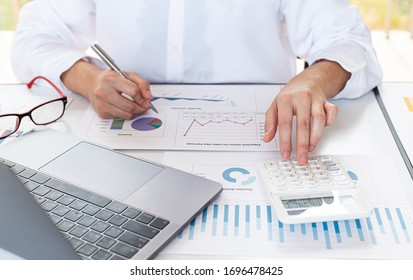 Accounting businessmen are calculating income-expenditure and analyzing real estate investment data, Finance and tax systems concept.
