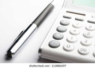 accounting concept with calculator and pen in business office