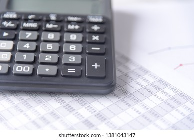 Accounting data with calculator and documents on table