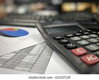 Accounting desktop, close up of review data in financial, working day in office, calculator and stationery on table, analysis finance report for business and accounting concepts.