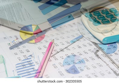 Accounting documents and a calculator placed at the table.Business Concept