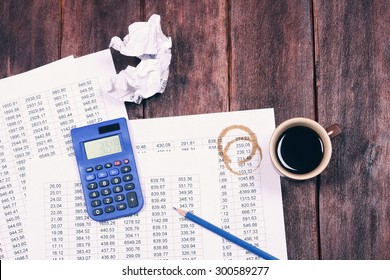 Accounting. Accounting documents. A Cup of strong coffee, tables of numbers calculator. Top view. Pencil, calculator, Cup of coffee. To make a mistake. Office life.